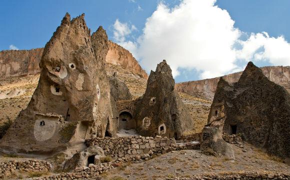"""Yılanlı Kilise"""" (Church with the Serpent) from the trail in Soğanlı Valley."""