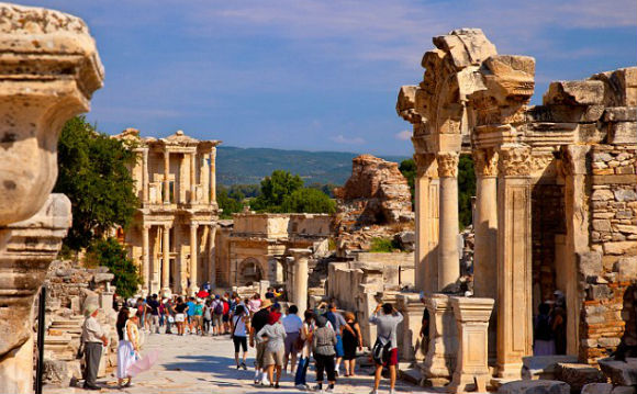 Towering history: Tourists walk the marble-paved street of Curetes, near the Temple of Hadrian and Library of Celsus, in Ephesus